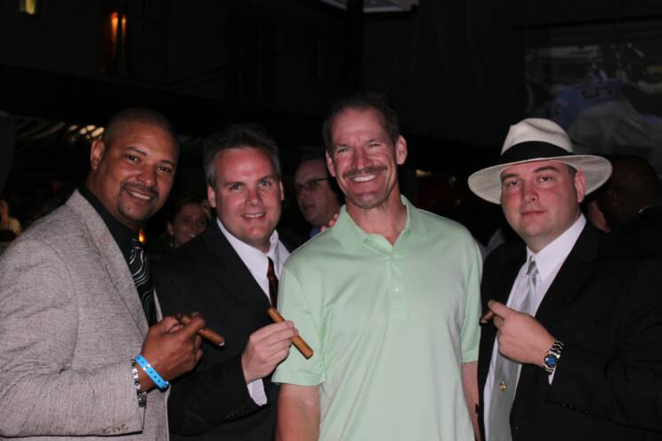 Walter Briggs enjoying one of his fine cigars with Super Bowl Coach Bill Cowher
